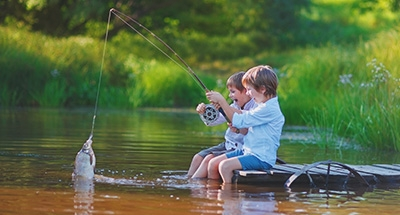 Children fishing together